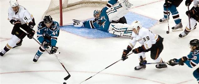 Anaheim Ducks goalie laying out to defend a San Jose Sharks shot, 9/21/2007.
